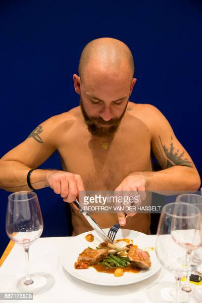 Graphic content / A diner eats in the nude at the newly opened nudist restaurant 'o'naturel' in Paris on December 5 2017 Leave your coats your pants...
