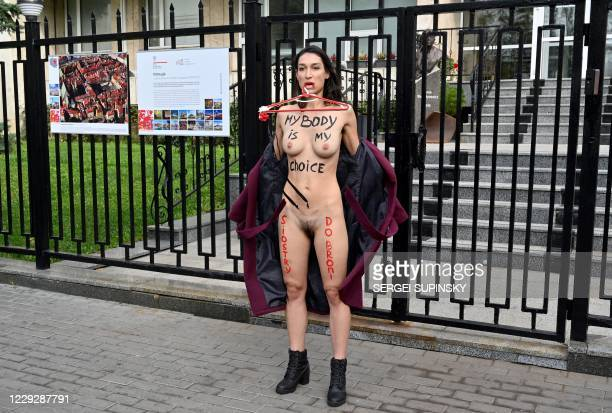Graphic content / A FEMEN naked activist stages an action at the Polish embassy in Kiev on October 26, 2020 in support of Polish women in their right...
