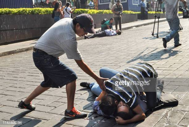 Graphic content / A man hugs a wounded man lying on the ground after a gunman opened fire in the central square of Cuernavaca Morelos state in Mexico...