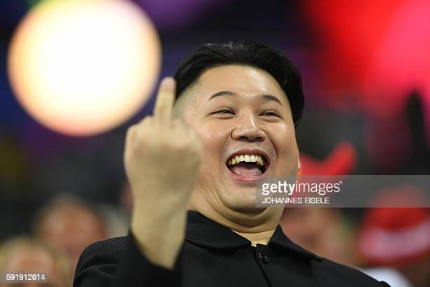 Graphic content / A man impersonating Kim Jongun gestures during the athletics at the Rio 2016 Olympic Games at the Olympic Stadium in Rio de Janeiro...