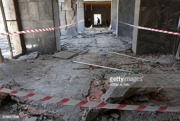 Graphic content / A man walks through rubble after the Grand National Assembly of Turkey was bombed by rebel jets on July 16 2016 in Ankara July 15...