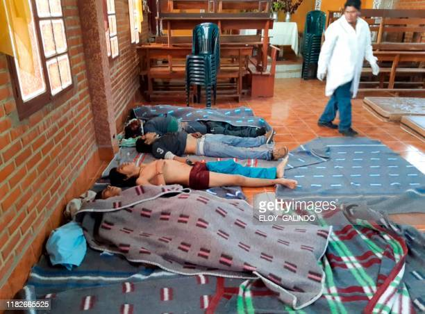 Graphic content / A medic looks at the bodies of five people killed during clashes between Bolivian riot police and supporters of Bolivia's...