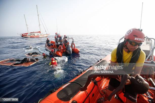 Graphic content / A member of the Spanish NGO Proactiva Open Arms carries a dead child as other members rescue a woman Cameroonian migrant Josepha...
