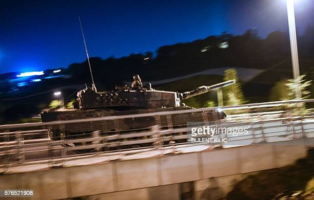 Graphic content / A military tank drives past during a coup attempt at entrance to the Bosphorus bridge in Istanbul on July 16 2016 Turkish military...