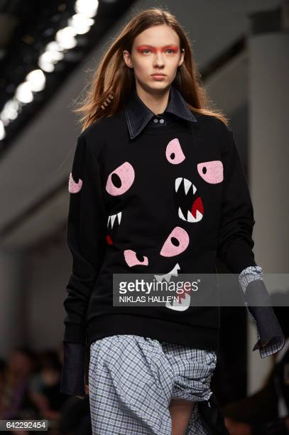 Graphic content / A model present a creation during the Fyodor Golan catwalk show on the first day of the Autumn/Winter 2017 London Fashion Week in...