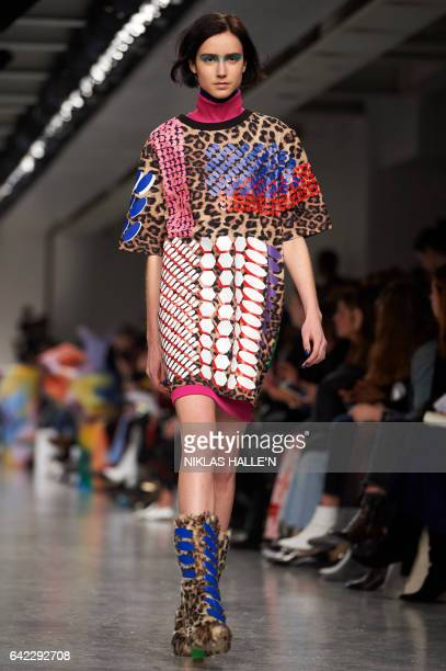 Graphic content / A model presents a creation during the Fyodor Golan catwalk show on the first day of the Autumn/Winter 2017 London Fashion Week in...