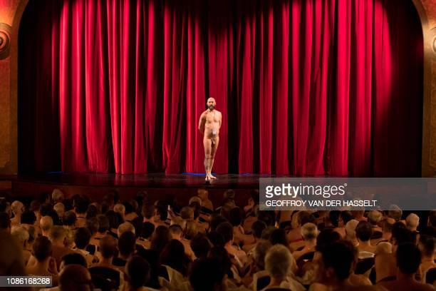 Graphic content / A naked man stands on stage as naked people attend the nudist play nu et approuve at the Palais des Glaces theatre in Paris on...