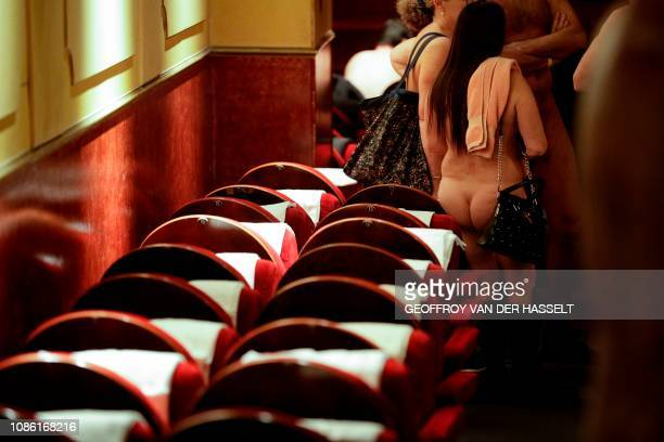 Graphic content / A naked woman attends the nudist play nu et approuve at the Palais des Glaces theatre in Paris on January 20 2019