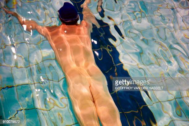Graphic content / A nudist takes part in a swimming lesson at the Roger Le Gall swimming pool in Paris on January 12 2018 Every week some hours are...