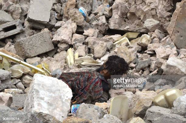 Graphic content / A picture taken in the city of Mosul shows a body of an alleged Islamic State group jihadist on January 11 2018 For three years...