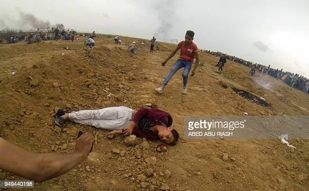 Graphic content / A picture taken on April 20 2018 shows the body 15yearold Palestinian Mohammed Ibrahim Ayoub when he was shot and killed by Israeli...