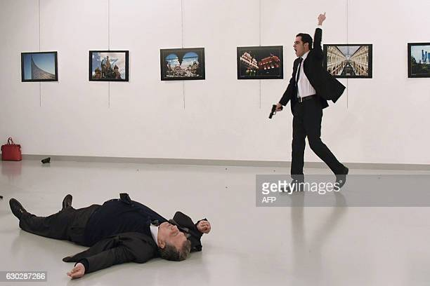 Graphic content / A picture taken on December 19 2016 shows Andrei Karlov the Russian ambassador to Ankara lying on the floor after being shot by...