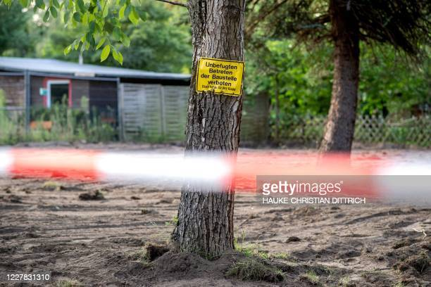 "Graphic content / A picture taken on July 29, 2020 shows a sign on a tree reading ""No entry to the property. Parents are liable for their children""..."