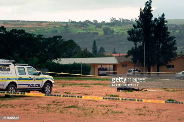 Graphic content / A picture taken on June 14 2018 in Malmesbury an agricultural town about 50Km north of Cape Town shows the body of a man alleged to...