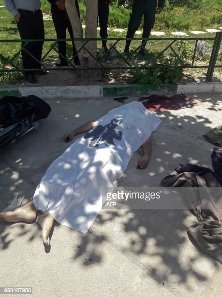 Graphic content / A picture taken on June 7 reportedly shows a covered body of a gunman outside the mausoleum of Ayatollah Ruhollah Khomeini in...