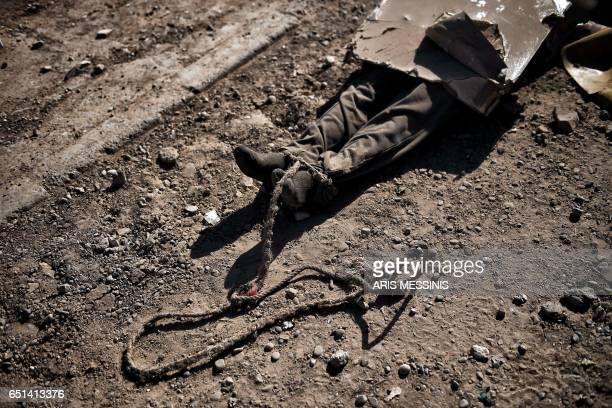Graphic content / A picture taken on March 10 2017 shows the body of a reported jihadist in west Mosul as Iraqi forces advance in the city in the...