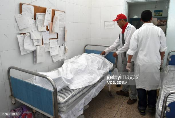 Graphic content / A picture taken on November 20 2017 shows a view of the bodies of victims lying in the local morgue in the coastal tourist town of...