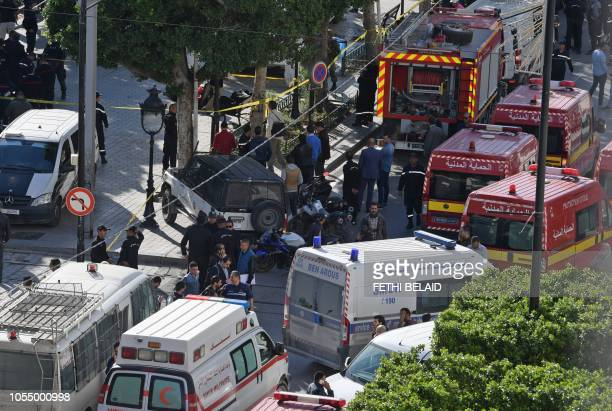 Graphic content / A picture taken on October 29 shows police and firemen gathering at the site of a suicide attack in the centre of the Tunisian...