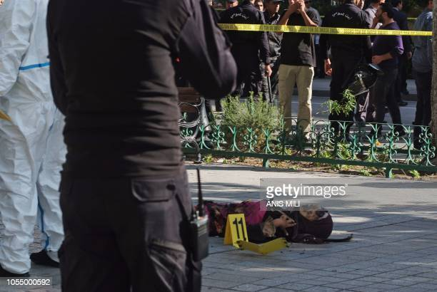 Graphic content / A picture taken on October 29 shows the body of a suicide bomber who blew herself up near police vehicles in the centre of the...