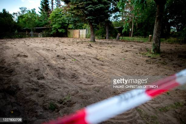 Graphic content / A police cordon can be seen at the site after the police finished a two-day search in a garden allotment in the northern German...