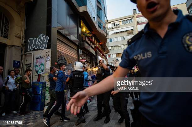 Graphic content / A protester is detained by police during a demonstration against the replacement of Kurdish mayors with state officials in three...