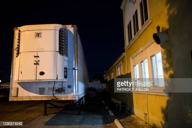 Graphic content / A refrigerated truck trailer stands parked outside of Continental Funeral Home, required to accommodate an influx of people who...