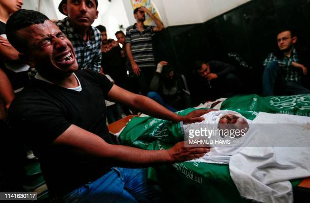 Graphic content / A relative cries over the body of Maria alGazali who was killed in Israeli strikes the previous day during a funeral ceremony at a...