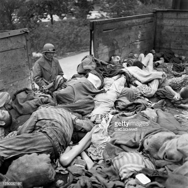 Graphic content / A soldiers looks at prisoner's dead bodies stacked in a train near Dachau concentration camp in late April or early May 1945, after...