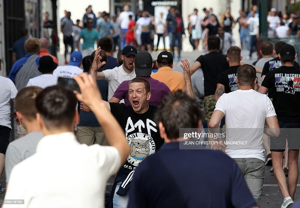 Graphic content / A supporter shouts during street brawls ahead of the Euro 2016 football match England vs Russia, southern France, on June 11, 2016. Football fans fought pitched battles for the third day in the French city of Marseille ahead of England's European Championship clash with Russia. Bare-chested English and Russian supporters hurled bistro chairs and bottles in the historic Vieux-Port district where the cobbled streets were littered with broken glass and debris. MAGNENET