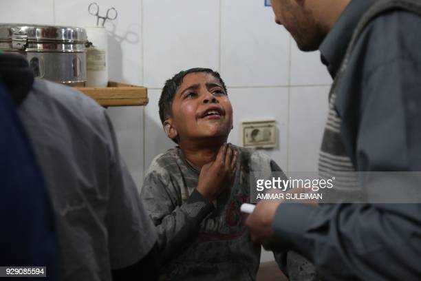 Graphic content / A Syrian boy wounded in reported regime air strikes on the rebelheld enclave of Eastern Ghouta receives treatment at a makeshift...