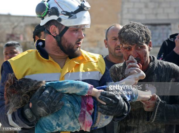 Graphic content / A Syrian man kisses the feet of his daughter who was killed following reported shelling in the town of Khan Sheikhun in the...