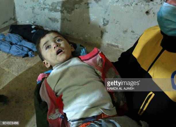 Graphic content / A Syrian medic holds the body of a child at a makeshift clinic following a suspected chemical attack on the rebelheld village of...
