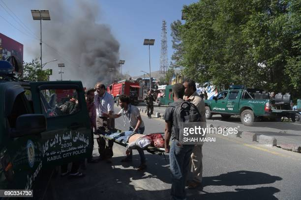 Graphic content / A victim is carried away on a stretcher at the site of a car bomb attack in Kabul on May 31 2017 A massive blast rocked Kabul's...