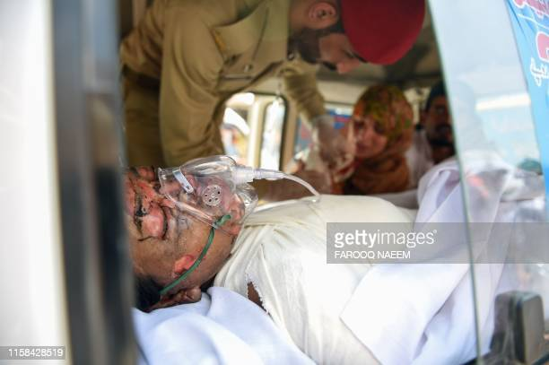 Graphic content / A woman lays in an ambulance to be transported to hospital after being injured when a Pakistani military airplane crashed into a...
