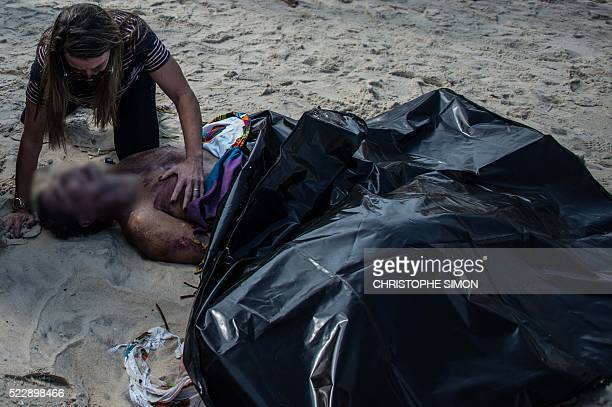 Graphic content / A woman mourns with her husband's corpse after the collapse of a recently inaugurated bicycle track in Rio de Janeiro Brazil on...