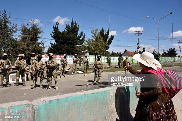Graphic content / A woman yells at soldiers guarding the Senkata fuel plant in El Alto, on November 20, 2019. - Three protesters were killed and 30...