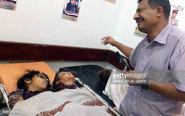 Graphic content / A Yemeni man cries next to the bodies of children killed by a rocket fired by Iranbacked rebels in a residential neighbourhood of...