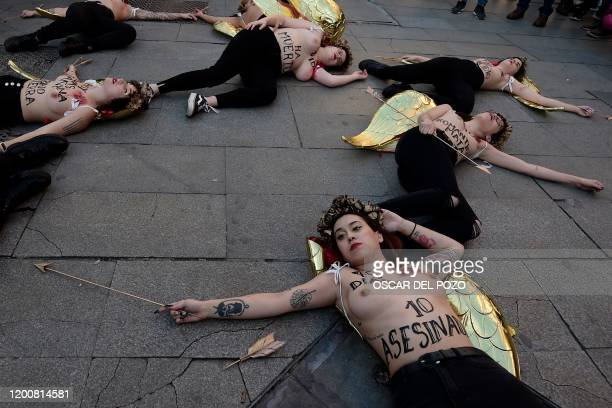 Graphic content / Activists of women's rights organisation Femen protest in Madrid on February 14 2020 during an action to denounce violence against...