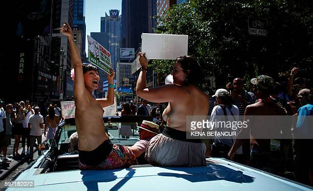 Graphic content / Activists take part in the GoTopless Pride Parade on August 28 2016 in New York Women around the US are going topless in...