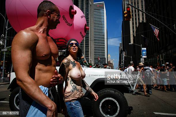 Graphic content / Activists takes part in the GoTopless Pride Parade on August 28 2016 in New York Women around the US are going topless in...