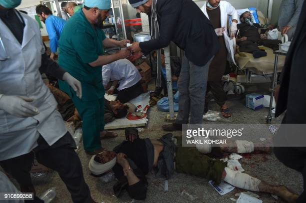 Graphic content / Afghan medical staff treat men and women wounded after a car bomb exploded at the Jamhuriat Hospital in Kabul on January 27 2018 An...