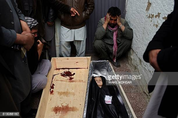 Graphic content / Afghan mourners surround the coffin of ninemonthold Faiz who drowned while his family were trying to cross the Aegean Sea between...