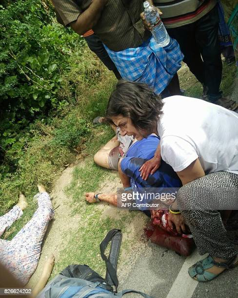Graphic content / An accident victim receives first aid after a minibus collided with a container truck in Punganur situated about 140km from...
