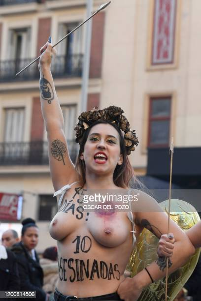 Graphic content / An activist of women's rights organisation Femen protests in Madrid on February 14 2020 during an action to denounce violence...