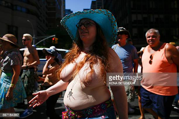 Graphic content / An activist takes part in the GoTopless Pride Parade on August 28 2016 in New York Women around the US are going topless in...