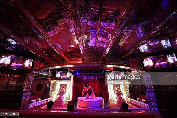 Graphic content / An actress performs on stage at the Bagdad nightclub in Barcelona on November 8 2017 Bagdad a notorious Barcelona nightclub with...