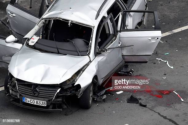 Graphic content / An aerial view shows the wreckage of a car after a blast caused by an explosive device killed its driver travelling down a street...