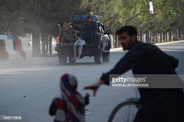 Graphic content / An Afghan police pickup truck transports injured victims following a suicide attack in Kabul on July 22 2018 A suicide attacker...