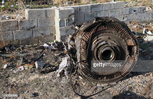 Graphic content / An engine lies on the ground after a Ukrainian plane carrying 176 passengers crashed near Imam Khomeini airport in the Iranian...