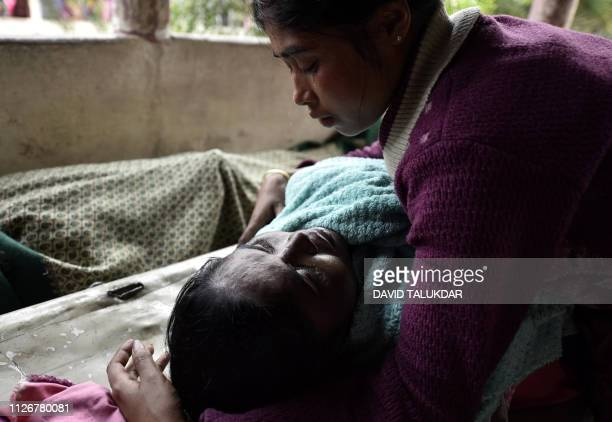 Graphic content / An Indian woman mourns over the dead body of her mother who died after drinking toxic bootleg liquor at Kushal Konwar Civil...